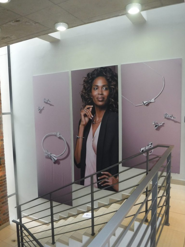 Corporate Stairwell Fabric Frame Branding | In Store Fabric Frame | Tension Frame System | Fabric Frame | Retail Branding with Fabric Frames