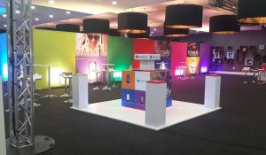 The Solutions Team | Circular hanging banners at event