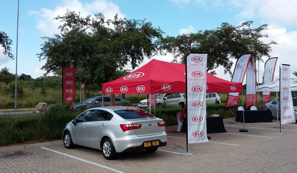 Outdoor Car Activation with Gazebo and Telescopic Banners | Branded Banners and Gazebos | Fabric Banners