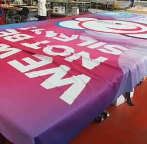 Cancervive fabric banner in quality control